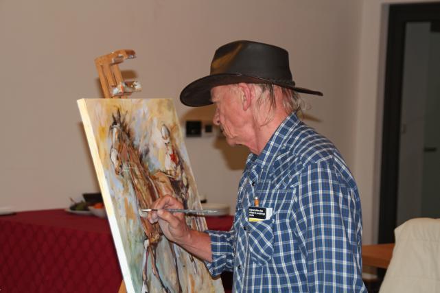 Umetnik med delom